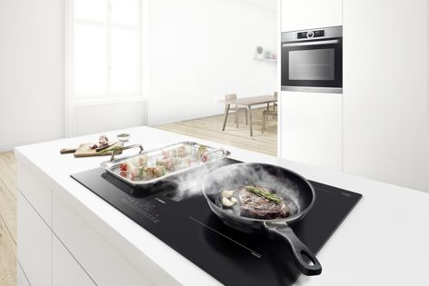 Bosch's new induction cooktop has an integrated ventilation module and multiple independently controlled cooking zones. The unit can be installed on benchtop islands.
