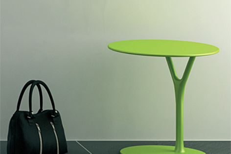 The Wishbone series side table is available in red, white, black and green.