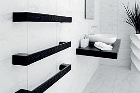 The Cracked Mud heated towel rail from DCS is available in either black or white.