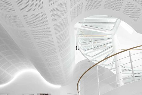 This curved ceiling was created with CSR Gyprock's Gyptone Flexible perforated plasterboard range.