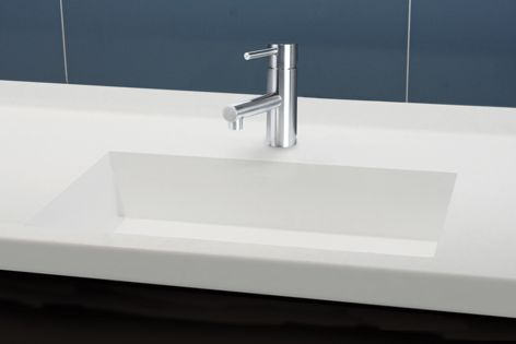 Corian allows sinks and benchtops to flow seamlessly, creating a beautiful design while also being a practical solution.
