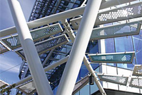 """Perforated aluminium panels are suspended in a """"cable grid"""" structure at Docklands in Melbourne."""