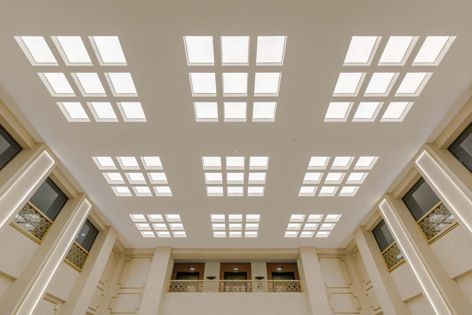 The heritage status of Chancery House presented the challenge of incorporating an effective acoustical ceiling while retaining the original aesthetic of the building's interiors.