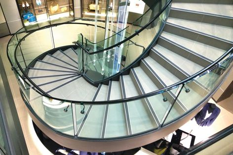 A stair at Hugo Boss's Sydney store, featuring Bent and Curved Glass.
