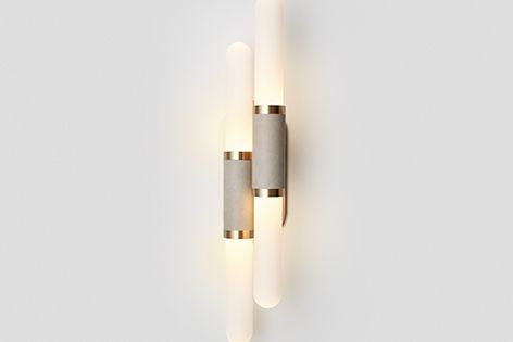 Articolo's Staggered Scandal wall sconce pairs two mouthblown glass shades.