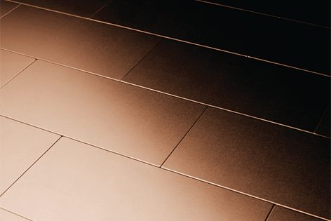 Alloy's 76 mm x 152 mm Subway tiles in copper make a striking statement.