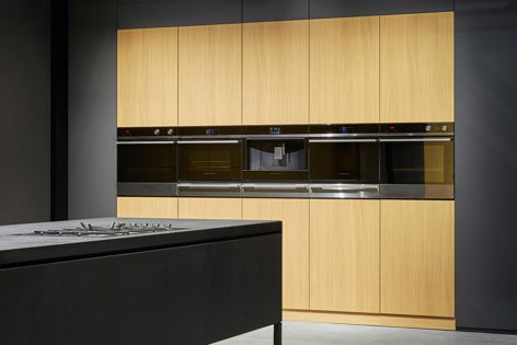 Fisher and Paykel's Companion Product range has a strong emphasis on integration and detailing, with black reflective glass and polished metal trim contributing to a seamless aesthetic and alignment.