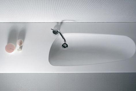 The rimless Laufen Washbasin 01 mimics a naturally eroded lagoon.