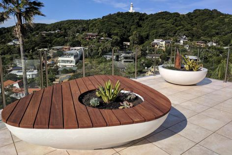 Delta street furniture pieces can be customized to include a timber deck top. The range has been designed to complement bowls, pots or planters, though it can also be supplied for standalone features.