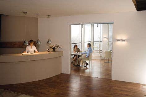 The elegant Dorma Magneo automatic door is ideal for professional environments as well as the home.