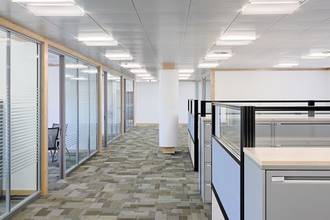 Opalized satin wings on the Officelyte 600 refract uniform light onto the ceiling of this office.