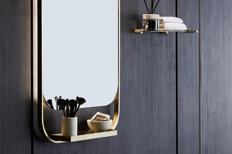 The stainless steel Cameo mirror includes a built-in shelf and LED backlights.
