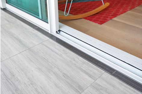 Stormtech's threshold drains allow seamless accessibility between inside and outside.