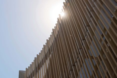 The Learning and Teaching Building at Monash University features a perforated metal facade. Photography: Rob Burnett.