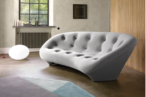 Available from Domo, the Ploum settee's unique upholstery combines a quilted stretchable textile covering with an ultra soft foam core.