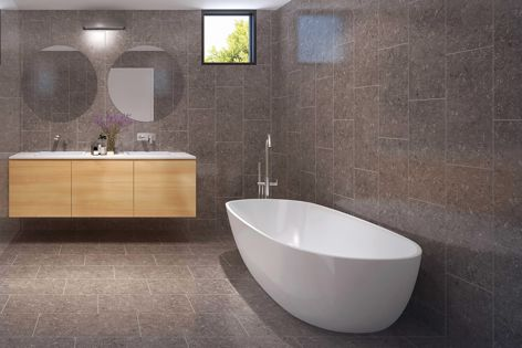 Fossile 'Latte' 300 mm × 600 mm porcelain tiles bring warmth and depth to this bathroom.