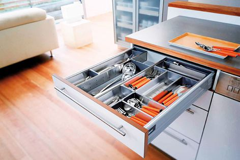 Stainless steel Blum Orga-line dividers, holders and trays can be fitted to Tandembox drawers.