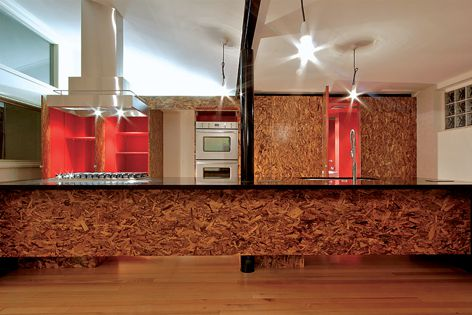 Kitchen by Maynard Architects is enlivened by the textured finish of  Oriented Stand Board.