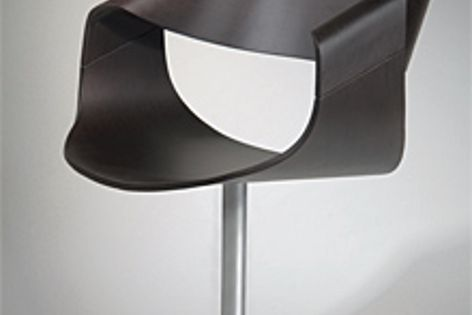 The moulded plywood shell of the Virage chair can be finished in a range of stained or solid colours.