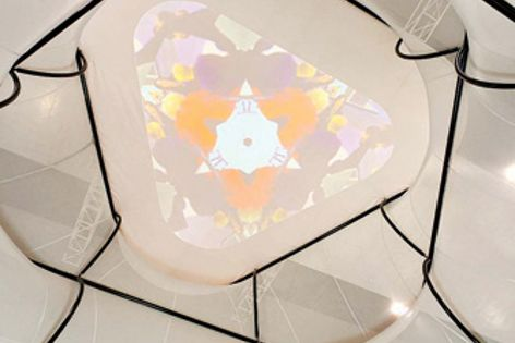 Tensile membrane technology can be used with fabrics to build architectural sculptures indoors.