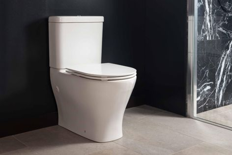 The Reach II back-to-wall toilet suite by Kohler features clean lines and a contemporary skirt.
