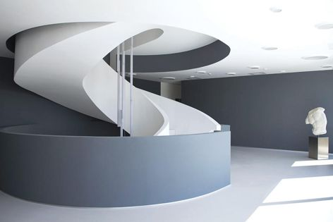 HI-MACS® solid surfaces were specified for this sculptural staircase. Photography: Francesca Bottazzin.