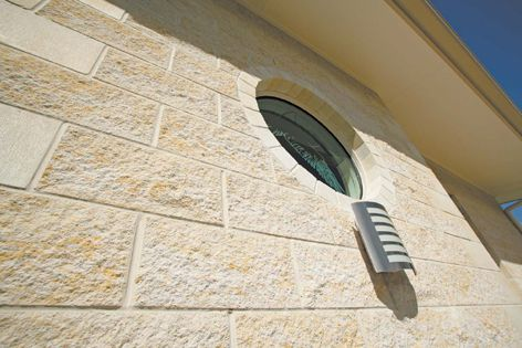 Sandblend sandstone blocks from GB Masonry give this facade a textured finish.