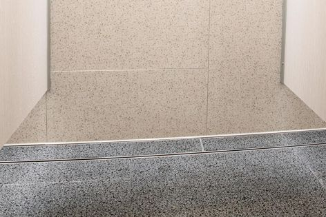 Stormtech's latest linear tile insert drain has a depth of only 23 mm.