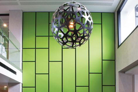 A two-storey feature wall is covered in Asona Triton™ Fabwall 40, wrapped in Textilla Bond Leaf fabric.