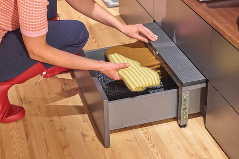 Extra storage is created with a pull-out located underneath the step.