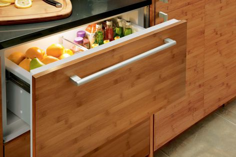 Sub-Zero's integrated fridge/freezer drawers are available with customizable fronts.