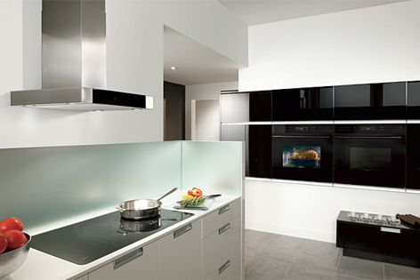 The black glass built-in ovens by Wolf offer ten cooking modes.