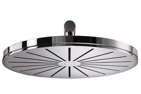 Vola's round head shower is available as a ceiling or wall-mounted unit to suit any bathroom composition.