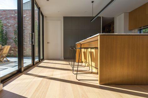 Australian Oak engineered hardwood flooring is hardwearing, with a sleek finish. Design: Orbis Constructions. Photography: DJWTV.