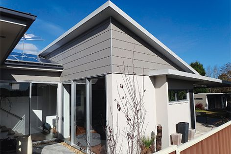 This house features SIP walls and Corrolink roof panels by Versiclad.