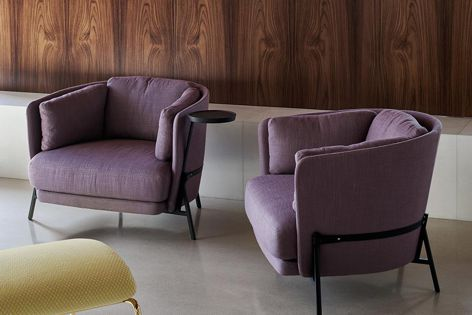 Stylish and comfortable Cradle armchairs have curved sides that embrace the sitter.