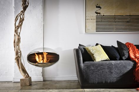 An Aeris model smoke-free fireplace from Cocoon Fires is shown here in stainless steel with a ceiling-suspended hanging mount.