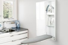 Mounted ironing board and storage cabinet