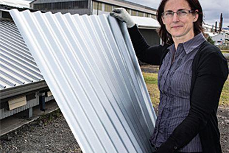 Bluescope Steel product durability team leader Tahnee Lowe with Next Generation Zincalume.