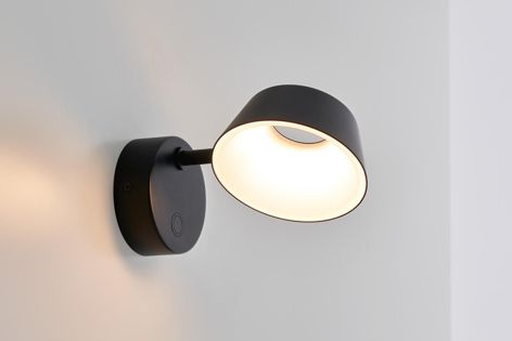 Shade-embedded LEDs minimize the glare from Olo wall lights.