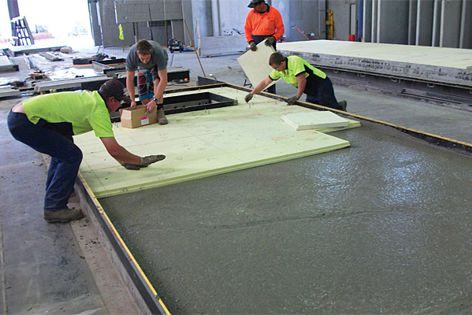 A layer of insulation is attached to a concrete layer.