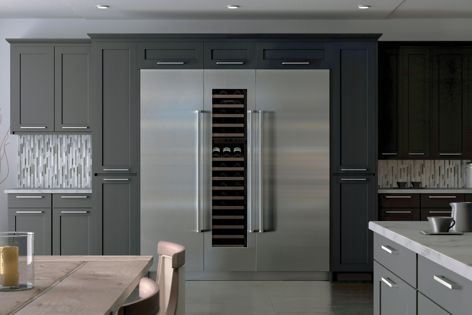 With no visible hinges or grilles, the units are designed to sit flush with adjacent cabinetry.