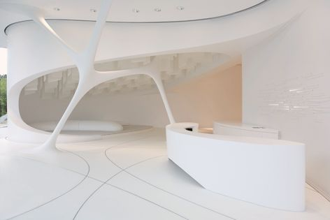 Solid surfaces from Laminex's new HI-MACS range, pictured here in 'Alpine White,' were specified for the Leonardo Glass Cube in Bad Driburg, Germany. Photography: Emanuel Raab. Design: 3deluxe.