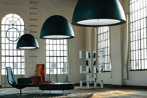 Available in white, brown or black, the Willy suspension lights were designed by Enzo Panzeri.