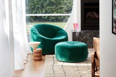 Pumpkin swivel chair and footstool by Ligne Roset