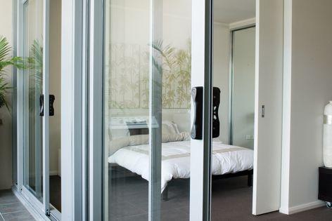 Alspec Altitude apartment sliding doors make expansive openings possible.