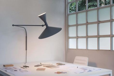 The Lampe De Marseille has a spun aluminium diffuser and is available with a matt grey or white body.